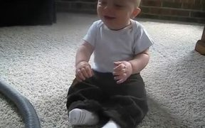 Baby Laughing At The Vacuum
