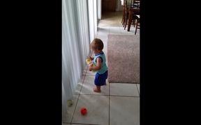 Toddler Struggles To Pick Up Balls