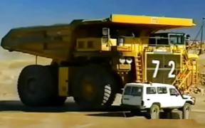 Huge Dump Truck Vs Car