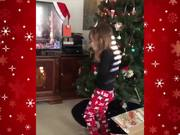 Cat Surprises Little Girl For Christmas