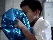 Kid Experiments Inhaling Helium