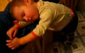 Kid Sleeps Standing Upright