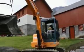 Three-Year-Old Operating A Real Excavator