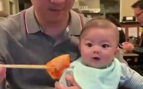 Toddler Reacting To Delicious Looking Food
