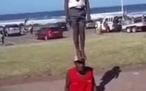 Man Took A Kid On His Head Literally