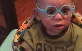 Sweet Kid And His First Pair Of Glasses