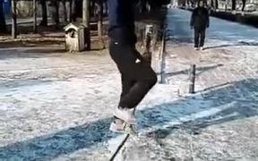 A Man Balances Himself On The Rope