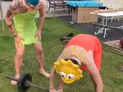 Two Men In Cosplay Lifting The Weight Bar