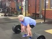An Old Woman Lifts A 220 Lb Weight