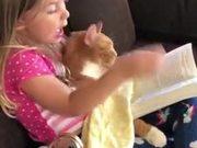 Little Girl Telling Her Cat A Bedtime Story
