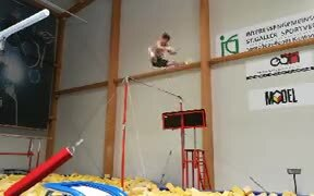 An Amazing Guy Pulling Off Tricks In Bar Swinging