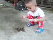 Tiny Kid Feeding The Tiny Birds