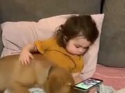 Baby Babysitting A Baby Golden Retriever