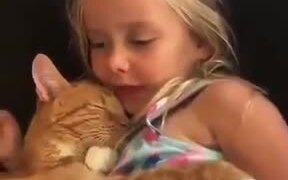 Cat Sleeping To A Child's Lullaby