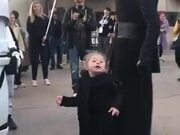 Cute Kid Smiles When She Meets The Jedi
