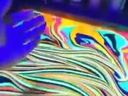 Dipping Arm In Psychedelic Paint