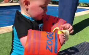 Baby Trying To Eat Banana While Wearing Floaties