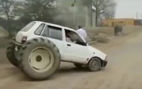 A Tiny Hatchback With Two Tractor Wheels?