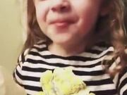 A Little Girl Struggling With Mommy's Food