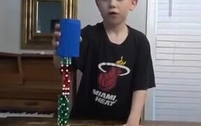 Little Kid Stacking 20 Dices