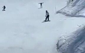 A Man Flying On The Snow