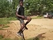 Boy Performing Impossible Unicycle Trick