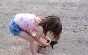 Little Girl Playing With A Frog
