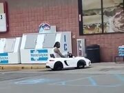 Man In A Children's Electric Car