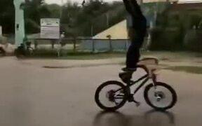 Australian Guy Riding A Bike In The Rain