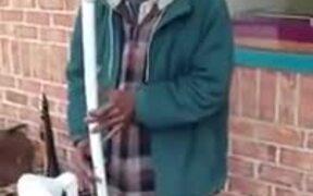 Man Playing Water Pipe Saxophone
