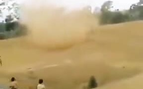 Indonesian Students Chasing A Sand Storm