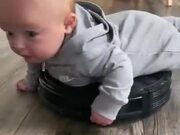 Baby Riding An Automatic Home Cleaning Machine
