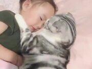 Cat Enjoying Sleeping With Little Girl