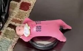 Toddler Enjoying A Ride On A Vacuum Cleaner