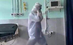 A Doctor Dancing In A PPE Kit