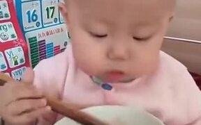 A Toddler With Fine Chopstick Skill