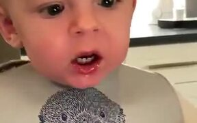 Kid Getting Frustrated To Blow Out A Candle