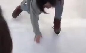Amateur Girl Trying To Stand On Ice Wearing Skates