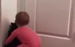 Cat Opening The Door For Baby