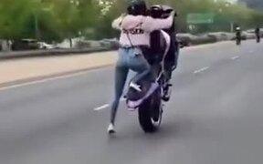 Biker Girl Performing Amazing Wheelie Stunt