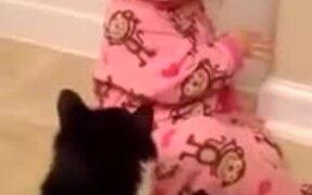 Cat Violently Hugging A Girl