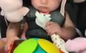 Baby Experiencing Vibrating Magic Ball