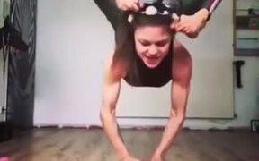 Girl Performing Gymnastics On A Ball