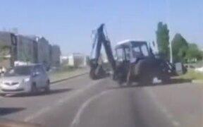Excavator On Road Loses Rear Wheel