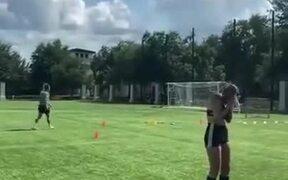 Football Shot Hitting A Bottle Over Woman's Head