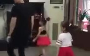 Man And Two Little Children Do The Shuffle