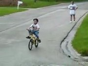 Little Kid on Bike Rides Into Pole