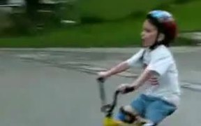 Little Kid on Bike Rides Into Pole