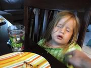 Little Girl Falls Asleep Eating Pizza