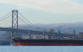 Cargo Ship Passing Under